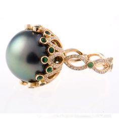 Perfection is a right hand ring by Erica Courtney. Eve - South Sea pearl w tsavorite setting