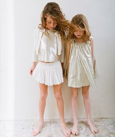 These lovely chicas look like dreams in this shot from @babiekinsmag featuring our Isabella dress, gold Lucia top and ivory Eloise skirt! #VelveteenClothing