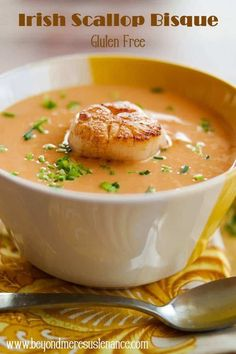 Luxurious flavors abound in this creamy Irish Scallop Bisque! It's perfect as an elegant starter course, or a light main course with bread and a salad... #glutenfreesoups #scallopbisque #seafoodbisque #seafoodsoups #scalloprecipes #soupcourse #globaleats #Irishscallopbisque #Seafood #scallops #scallopbisquerecipe