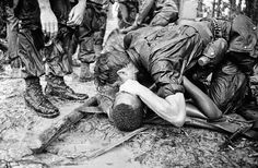 A trooper of the 101st Airborne Division attempts to save the life of a buddy at Dong Ap Bia Mountain, near South Vietnam's A Shau Valley on May 19, 1969. The man was seriously wounded in the last of repeated attempts by U.S. forces to capture enemy positions there