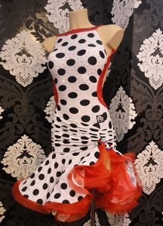 This white and black polka dot latin dress with red accents is a fun dress especially well suited for jive. Visit http://ballroomguide.com/comp/attire/lady.html for more info about competition attire.