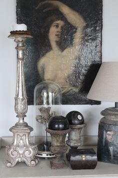 Crackled oil painting with intense light and dark. Lovely subject. Charming focal point for this vignette.