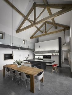 High ceilings with exposed wooden beams in renovated old English barn house