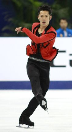 Daisuke Takahashi of Japan performs to a Rock'n'Roll medley at 2012 Cup of China