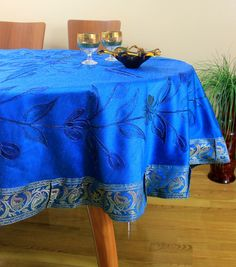 Vibrant, bold ocean blue hand painted round #tablecloth. Crafted in India.
