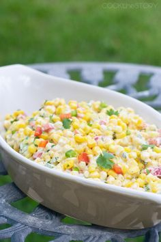 Spicy Summer Corn Salad Recipe - Sweet corn, peppers, onions, and jalapenos are tossed together with a warm cream cheese sauce. This side dish will be gobbled up quickly!
