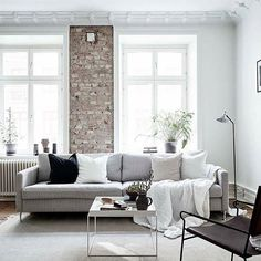 Scandinanvian living room, white interior, Scandi home, interior decor, interior styling, neutrals, light, textures, exposed brick, home decor. . Styled by @greydeco.se for @stadshem. Pic by @fotografjonasberg