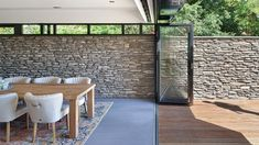 This natural stone wall runs from the inside to the outdoor space leaving a spatial effect. Design by BNLA architects, photography by Studio de Nooyer. Door Design, Exterior Design, Interior And Exterior, House Design, Natural Stone Wall, Luxury Interior Design, Art Of Living, My Dream Home, New Homes