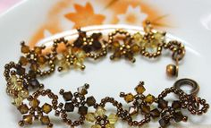 Make a bracelet that's perfect for the cooler seasons and lovely to wear. The Floral Autumn Fantasy Bracelet is an enticing blend of intricate design and rich color.