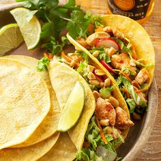 Thai Chicken Tacos - Get the best of the East and West with these global chicken tacos. Cilantro, peanuts, and chili sauce blend with chicken and warm corn tortillas for a bold fusion of Thailand and Mexico.