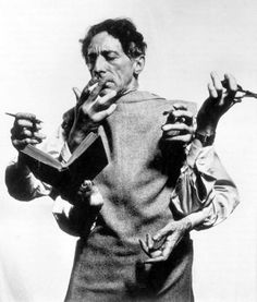 Portrait of Jean Cocteau by Man Ray. Man Ray was a pioneer of surreal photography. His layering of images and play with exposure and development, resulted in composed images / realities. Man Ray, Famous Photographers, Portrait Photographers, Milly La Foret, People Reading, Foto Picture, Philippe Halsman, Foto Portrait, Man Portrait