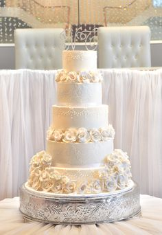 Classic white wedding cake by Coco Cakes... Personalized Cake serving sets...  http://thevineyard.carlsoncraft.com