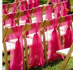 Chair sashes for wedding: under & up and draping at end... But gold sashes on black folding or white folding chair