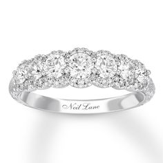 From celebrity jewelry designer Neil Lane comes this dazzling anniversary band. The ring showcases a brilliant row of round diamonds bordered above and below by more diamonds. Fashioned in white gold, the ring has a total diamond weight of 1 carat. Anniversary Bands For Her, Diamond Anniversary Bands, Vintage Anniversary Rings, Anniversary Boyfriend, Boyfriend Birthday, 25th Anniversary, Celebrity Jewelry, Rings For Her, Diamond Stone