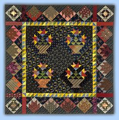 The central blocks are Carolina Basket designed by Judy Martin for her book, The Block Book. The quilt is by Roberta Horton: Lectures-Quilts
