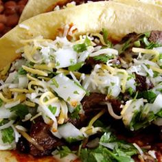 ... carne asada tacos (beef tacos). These are served on the soft corn