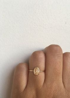 Tiny Gold Miraculous Medal Virgin Mary Ring by charlieandmarcelle Jordyn Miller Cute Jewelry, Jewelry Box, Jewelry Accessories, Stylish Jewelry, Cheap Jewelry, Jewelry Trends, Dainty Gold Jewelry, Dainty Ring, Yoga Jewelry