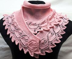 A narrow scarf / shawlette / collar in garter stitch, wider at the middle and narrow at the tips, with a leaf-lace edging. Looks like a Turkish pattern forum, much repinned, but can't find a source in any language with more than the photo. Anybody got more?