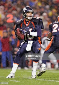 96b82af7e8b Quarterback Jake Plummer of the Denver Broncos passes against the Baltimore  Ravens October 9 2006 at