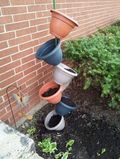 I simply took a garden rod and 6 pots...drilled holes in the bottom and slid them on the rod in alternating ways....voila!!! We are so handy now :)