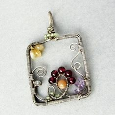 Lots of DIY jewelry tutorials from Michaels. Wire Pendant, Wire Wrapped Pendant, Wire Wrapped Jewelry, Metal Jewelry, Pendant Jewelry, Beaded Jewelry, Silver Jewelry, Wire Wraping, Bijoux Fil Aluminium