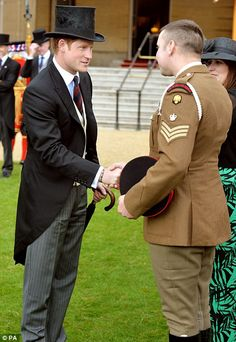 Prince Harry talks to Corporal of Horse Jamie Elliot