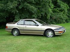 Gold 1989 Honda Prelude SI/4WS (Four Wheel Steering) Edition  My first car!  Wish I would have kept it to tool around in.