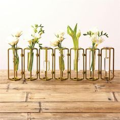 """These Our Lavoisier flower vases are inspired by classic laboratory equipment and have a vintage industrial feel - each piece is hinged so that it can be rotated and arranged in various positions. These vases are named for Antoine Lavoisier, the Fre Flower Vase Design, Flower Vases, Vase Centerpieces, Vases Decor, Table Decorations, Small Hinges, Glass Hinges, How To Iron Clothes, Burke Decor"