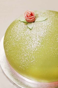 First made for the royal family, the Swedish Princess Cake contains layers of vanilla sponge, raspberry jam and vanilla cream, coated in green marzipan.
