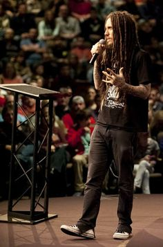Brian Welch, a co-founder of the band Korn, speaks to a capacity crowd Saturday at La Croix Church in Cape Girardeau. Welch spoke about his struggles with an addiction to methamphetamine and how his faith allowed him to overcome.