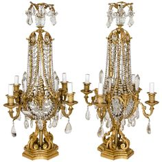 Pair of Antique French Louis XVI Style Gilt Bronze and Crystal Candelabra Lamps | From a unique collection of antique and modern table lamps at https://www.1stdibs.com/furniture/lighting/table-lamps/