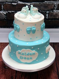 "Christening Cake This was made to celebrate Kaiden Dean's Christening day.  The cakes are an 8"" and a 4"" chocolate biscuit cake.  Design supplied.  www.perfectionistconfectionist.com"