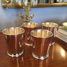 "The Sterling Saddle on Instagram: ""Set of four super cool vintage men's tennis trophy julep cups ... 1965-1968.  No major dings and overall nice condition with some  minor…"" Tennis Trophy, Vintage Men, Antique Silver, Barware, Cups, Conditioner, Cool Stuff, Antiques, Nice"