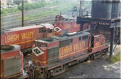Several Lehigh Valley units including RS11 #402, U23B #508, C420 #408, and an EMD switcher congregate on the ready tracks at the Sayre, Penn...