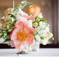 Coral Charm peony, hellebores, lisianthus, jessamine vine Photo by Hunter McRae