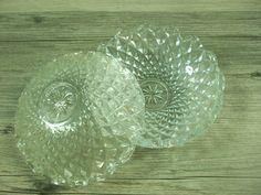 Vintage glass diamond cut jewelry box Small round clear glass dishes with scalloped edges that fit over each other Can be used separately as trinket dishes, jewelry dishes, candy dish or votive candle holders Approximate size 4 inch diameter with stacked height of 2 1/4 inches Marked Italy  ***Good condition, light wear.*** See the rest of my shop: https://www.etsy.com/shop/SwellSource