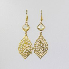 Gold paisley filigree earring with diamond shaped by twixtdesigns, $24.50