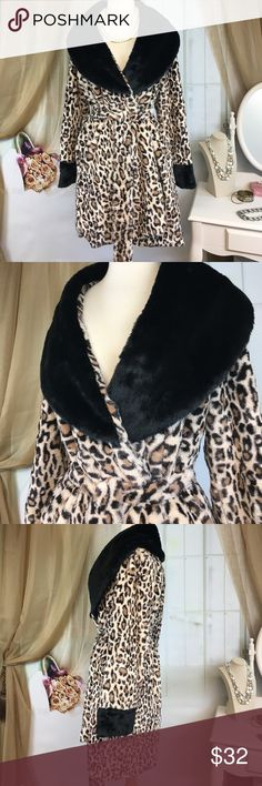 """Betsey Johnson Leopard Fuzzy Robe Love this robe! Super soft! Large black collar.  Fully lined to keep you toasty warm in the dead of winter.  Has 2 pockets.  100% polyester. Collar is 74% acrylic and 26% polyester. Great condition and wonderfully made.  Size L.  Bust measured flat armpit to armpit 19"""" and length 34"""". Betsey Johnson Intimates & Sleepwear Robes"""