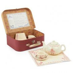 Tea-time Case & Set This splendid burgundy Tea-time set and carry case from Moulin Roty will make your little one the perfect luncheon hostess. The pottery set comes in a neutral cream finish which is finely decorated with burgundy floras and illustrations. Perfect for play-dates, they will be then envy of all their little friend