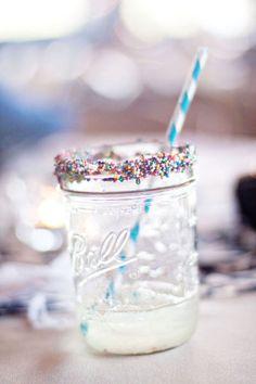 Encrust the rim of a small jar with rainbow sprinkles
