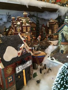 "Scene from our 2014 Dickens Village. Bought this ""Watlings Ships and Sails"" while on vacation in Lunenburg Nova Scotia"