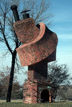 Unusual twisted brick building with horns stuck into it.  Building by Dennis Oppenheim