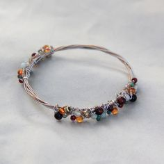 Guitar String Bracelets artfully crafted by Anne Shackelford from strings played on by musicians in Austin, Texas!