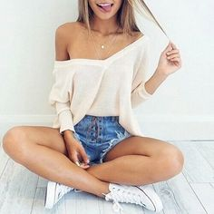 Off the shoulder white cream long sleeved top with denim shorts and white converse