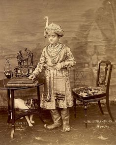 Krishnaraja Wadiyar IV, the Maharaja of Mysore by M. Burahnudin, 2nd February, 1895. This photograph is from the Elgin Collection: 'Autumn Tour 1895. Vol II'. Born June 4th 1884 the Maharaja succeeded to office as a minor on the death of his father. Krishnaraja Wadiyar IV is regarded as one of the most enlightened rulers of modern India; he is credited with transforming Mysore (modern Karnataka) into a model princely state and his period of rule has often been called the 'Golden Age of…