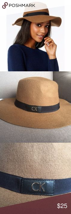 Calvin Klein Ck Patch Wool Felt Panama Hat NEW You will receive the exact item as pictured, please look closely at pictures. First picture is a stock photo. Brand new, tags attached.  Calvin Klein Women's Ck Patch Wool Felt Panama Hat in the color Pecan with Black Band and Gold CK Logo  Wool felt fedora with pinched crown. Grosgrain hatband with signature logo patch. Floppy brim with raw edge. Interior sweatband provides added comfort. 100% wool. Spot clean only. Imported.  Measurements…