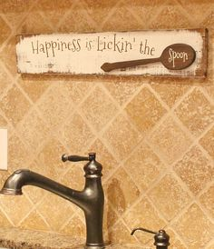 Happiness is lickin the spoon distressed wall art. Made of reclaimed pallet wood, the spoon has been hand cut from pallet wood and is a spoon overlay on the sign. Measures approx. 24 inches long and 5 inches wide. Comes with a saw tooth hanger for easy hanging. Perfect for any kitchen. Warm and comforting quote. Who doesnt remember licking the spoon as a child and the memories it creates. What a wonderful gift this would make for anyone who likes to bake and cook. Gift for grandmas kitchen a…