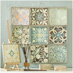 DIY custom wall art made from wood, stencils, and craft paint.