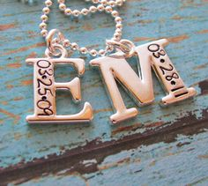 first letter of your child's name with her or his birthday engraved on it, via Etsy. Love this.