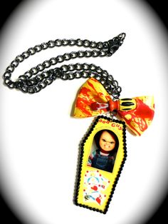 Chucky Good Guy Doll Coffin Shaped Necklace. $16.50, via Etsy.http://www.etsy.com/shop/PinkPandemonium?ref=top_trail